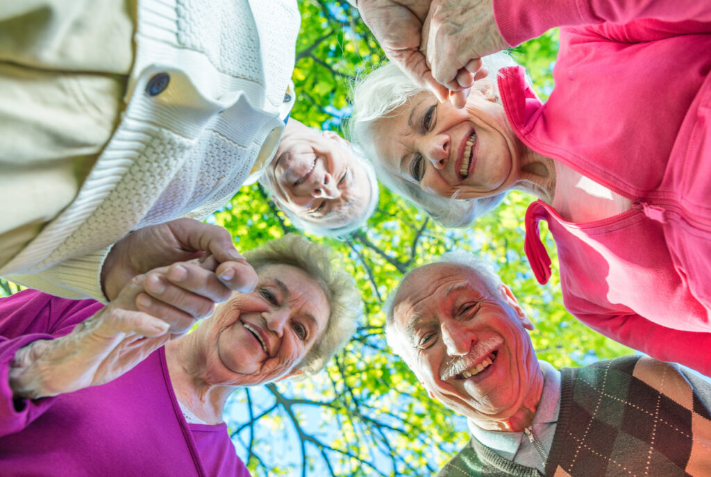 Upward view of two elder couples smiling
